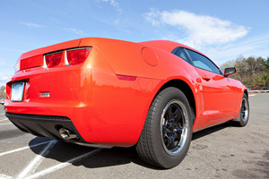 Rear close up of a modern orange sports car.