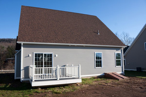 Rear view of a modern custom built house newly constructed with a walk out porch.