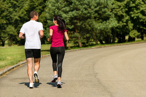 Rear view of jogging Caucasian couple outdoors