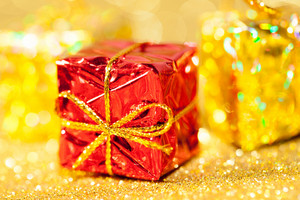 Red and gold gift box with out of focus lights
