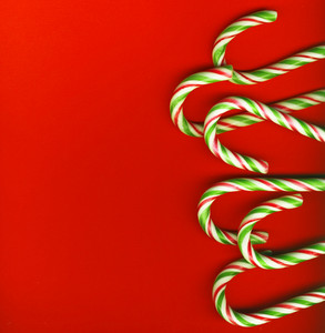 Red And Green Christmas Candy Canes Isolated On Red