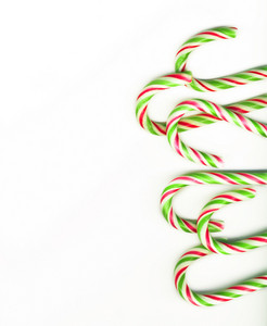Red And Green Christmas Candy Canes Isolated On White (real Photo)