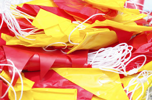 red and yellow flag paper