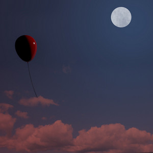 Red Balloon Soaring At Night Representing Freedom Or Being Alone