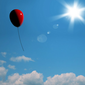 Red Balloon Soaring Representing Freedom Or Being Alone