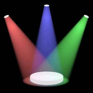 Red Blue And Green Spotlights Shining On A Small Stage With Black Background
