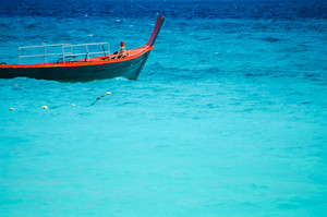Red boat on beautiful blue sea from South Thailand, Asia
