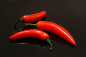 Red Chillies On Black Bachground