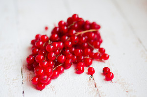 Red Currants On White Wooden Table
