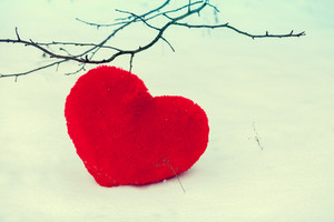 Red heart on the snow