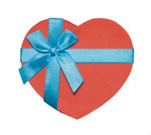 Red heart-shaped box tied with blue ribbon and bow