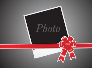 Red Ribbon And Card On Gray Background