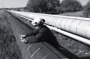 refinery worker and main oil and fuel pipeline
