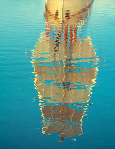 Reflection of sailboat on sea