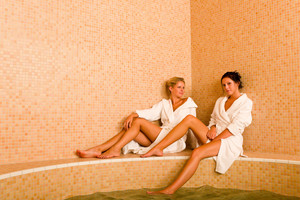 Relax bath spa two beautiful women bathrobe sitting water jacuzzi