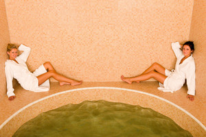 Relax bath spa two beautiful women sitting by water jacuzzi