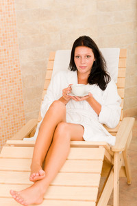 Relax luxury spa beauty woman drink coffee wear bathrobe lying sun-bed