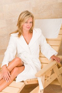 Relax luxury spa beauty woman in white bathrobe sitting on sun-bed