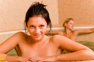 Relax spa pool two naked women inside water beauty health