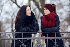 Relaxed Women in Serious Conversation Outdoors
