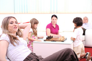 Relaxed young woman with family at home