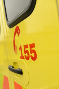 Rescue team's telephone number on yellow ambulance car