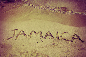 Retro inscription Jamaica on beach sand