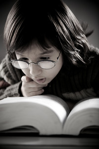 Retro portrait of cute little boy reading book