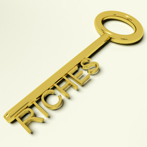 Riches Key Representing Wealth And Fortune