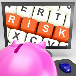 Risk Keys On Monitor Showing Investment Risks