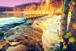 River with waterfall in autumn