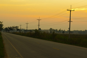 Road to nowhere with sunset sky
