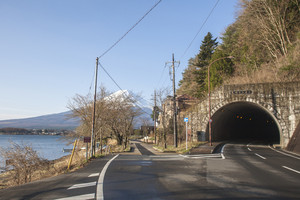 Road to tunnel at Japan with Mt Fuji view and lake