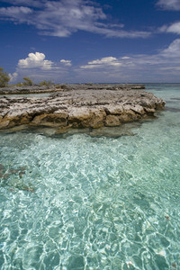 Rocks along clear, tropical waters