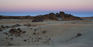 Rocks on a barren landscape at sunset