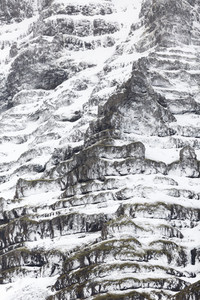 Rocky cliff covered in snow