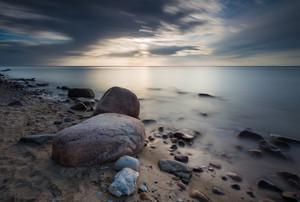 Rocky sea shore. Long exposure photo. Baltic sea shore.