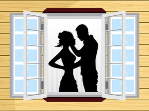 Romantic Couple Silhouette On Window
