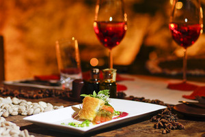 Romantic salmon steak dinner with red wine