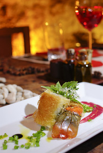 Romantic salmon steak dinner with red wine