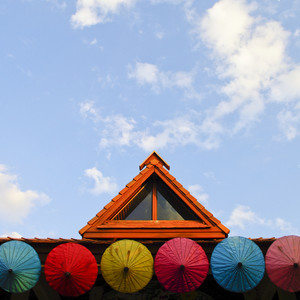 Roof house with colorful umbrella