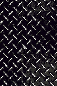 Rough and textured high contrast diamond plate background in black and white.
