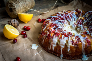 Round Lemon Cranberry Glazed Cake On The Paper -thanksgiving And Christmas Dessert