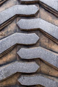 Rubber tire tread texture of a tractor or other heavy duty construction machinery.