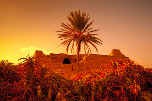 Ruins of Caesarea fortress at sunset