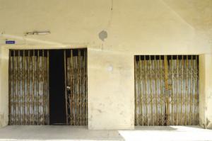 Rusty steel doors with yellow wall