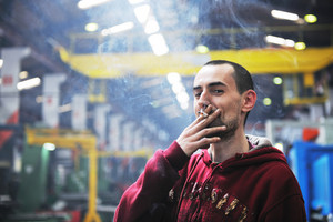 Industry Worker Smoke Cigarette