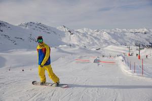 Snowboarder extreme jump