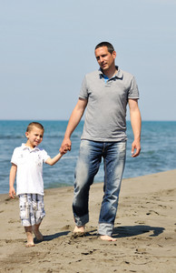 Happy Father And Son Have Fun And Enjoy Time On Beach