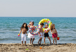 Child Group Have Fun And Play With Beach Toys